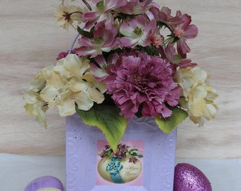 Easter Arrangement Mauve and Pale Yellow Florals in Lavender Container