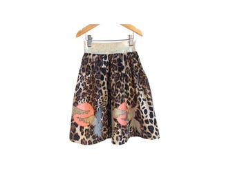 one123one Leopard kids skirt with applique sun and birds.
