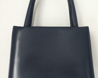 Vintage stylish darkbleu leather handbag made by the Dutch Brand Zumpolle