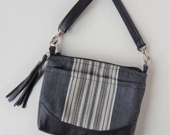Charcoal and black crossbody bag, with leather trim.