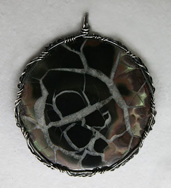 Septarian stone wrapped in a Celtic style with oxidized silver