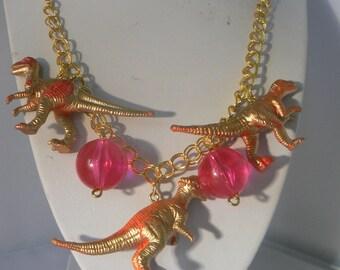 gold neon dinosaur necklace statement