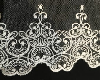 White lace, embroidered on tulle, lace trim, scallop edged. 11.5 cm wide. WH202