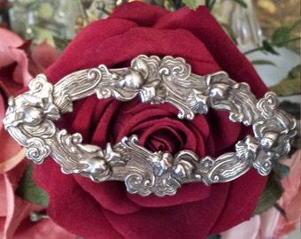 Sterling silver vintage decorative scrolling brooch
