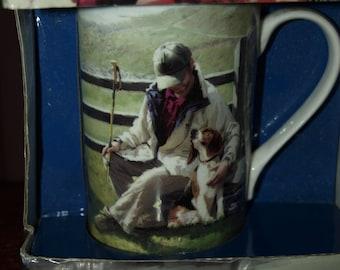 Man Sitting with a Dog Mug