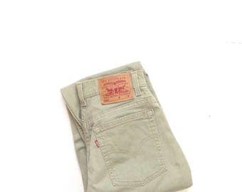 Khaki Levis 550. W28 L30. high waisted, worn in, tapered leg, soft tan jeans. Made in USA.