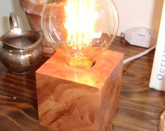 Great looking redwood burl table lamp with a BUILT-IN DIMMER switch and an Edison old world bulb.
