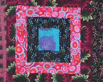 """Ragtime on the Roof quilt by Barbara Brackman. Art quilt 36"""" x 47"""" from Moda line Ragtime."""