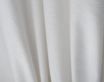 """Drapery Interlining,  59"""" wide Fabric, Color White, sold by the yard."""