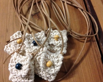 Cotton amulet necklace.