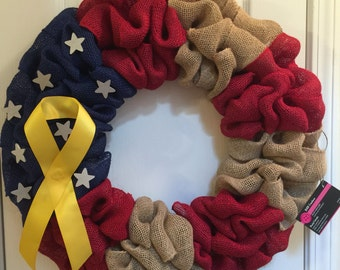 American flag wreath with yellow ribbon