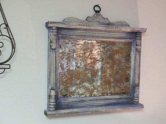 Antiqued frame fireplace decor antique mirror severely