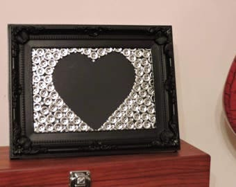 Black and silver button heart frame