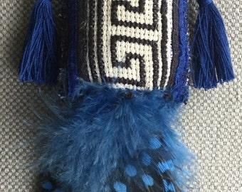 Textile necklace talisman, blue, white and black.