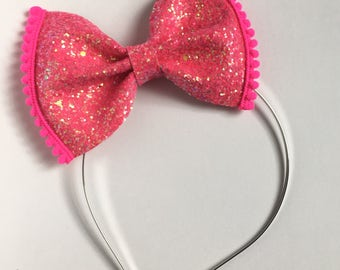 Bright pink neon pink Glitter bow, pom pom metal headband with rubber tips