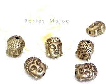 Lot de 2 perles tête de bouddha métal couleur bronze clair dimensions 11x9x8 mm