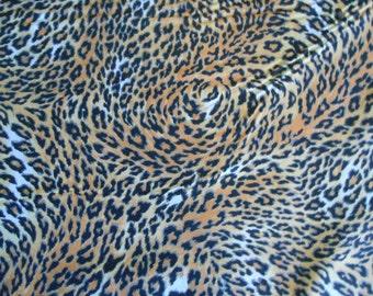 cheetah cotton fabric by the yard black brown orange white