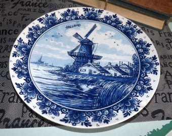 Late mid-century (c. late 1950s) Delfts Blauw | Royal Delft 304 Agro blue-and-white plate. Hand-painted windmill, flowers, birds. Holland.