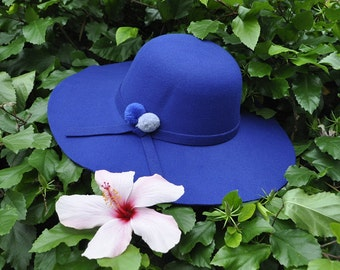 Blue Hat grey and blue PomPoms
