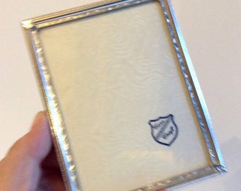 Lot of 3 Mid century silver picture frames. Small ornate silver photo frames with velvet easel back. 3 small silver wall frames.