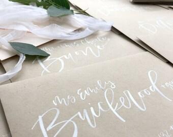 Custom envelope addressing - white ink brush letter