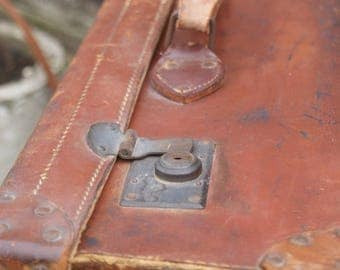 Large vintage brown leather suitcase
