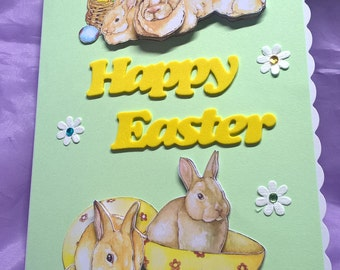 Easter bunny card with cute bunnies,eggs and flowers in 3d card