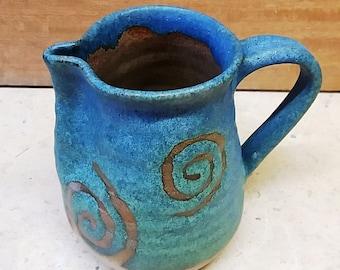 Spiral decorated ceramic Jug