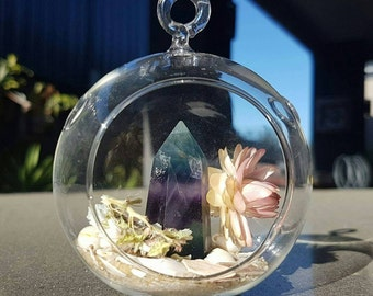 Small round glass terrarium with Fluorite crystal point