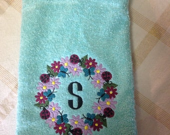 This monogrammed towel is embroidered on a hand towel.  Can be put on a kitchen towel as well.