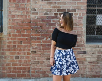 blue and white pleated floral skirt