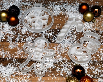 Christmas Cookie Cutters x 4 - Snowman, Gingerbread Man, Bauble, Candy Cane