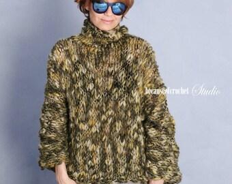 100% merino wool handknit bulky woman sweater. Size S-M. Made from italian pure virgin wool yarn.