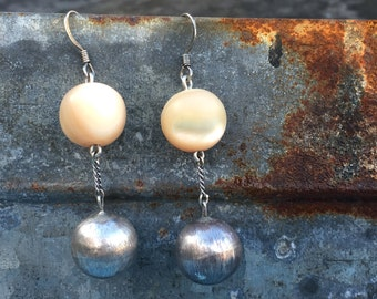 Earrings of large, antique mother of pearl beads with vintage tooled sterling balls, chains and findings