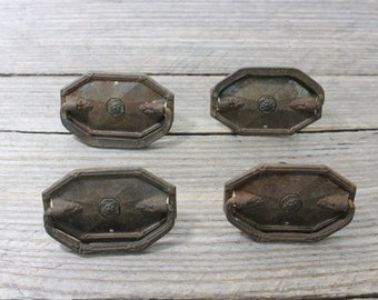 Set of four antique metal drawer pulls. Classic antique drawer pulls