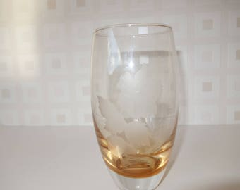 Burnt orange glass vase etched with a rose