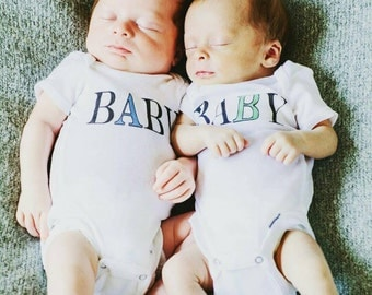 Baby A Baby B (front) #FirstName (back) cute onesies&tees for twins! Comes in a set of 2-choose font color and customize hashtag!