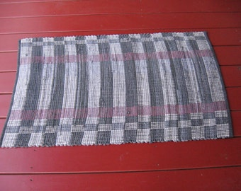 Handwoven wool blend rug grays, muted reds