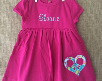 Embroidered Baby Dress with Heart Shaped Peace Applique