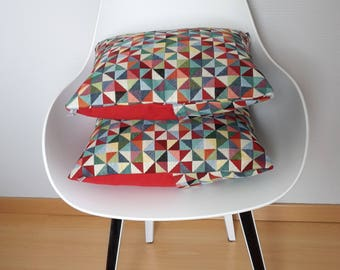 Red and multicolored geometric patterned pillow cover