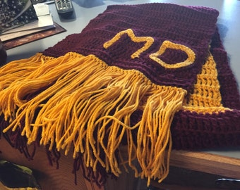Hand crocheted personalized scarf.