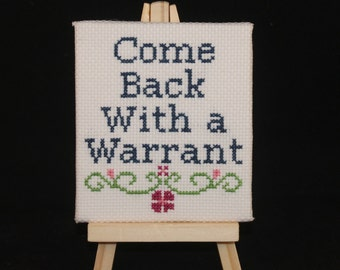 Come Back With A Warrant - Completed Cross Stitch