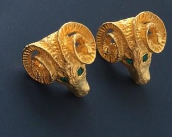 Unique vintage ram's head earrings .