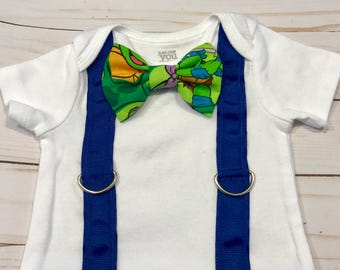 Baby boy Ninja Turtles snap on bowtie onesie! Choose Michaelangelo, Leonardo, Rafael, or Donatello!