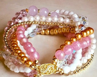White pink and gold braided beaded bracelet