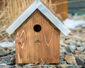 rustic wood birdhouse with arrow accent