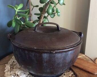 Antique or vintage cast metal cauldron primitive fire place hanging bean pot Colonial kitchenware