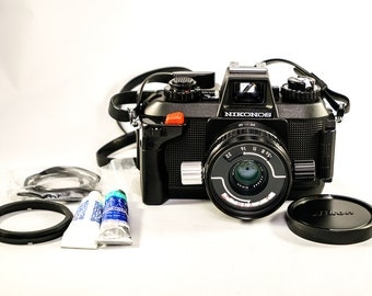 Brand New NIKONOS IV-A Underwater Film Camera with W-Nikkor 35mm F/2.5 Lens and optional Sunpak Marine 32 Flash/Strobe