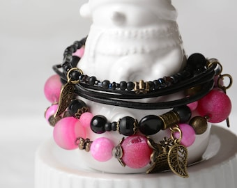 Bracelet beads and pink and black agates. Black leather.