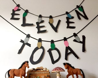 Stranger things party banner featuring Eleven Today, birthday garland, party decoration